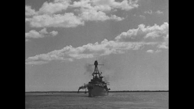 stockvideo's en b-roll-footage met fdr renews peace pledge / us navy warship houston carrying pres franklin roosevelt sails into harbor at charleston / closer shot of uss houston /... - hoofddeksel