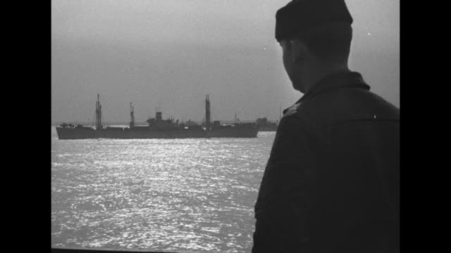 """""""february 1944 - on the atlantic - 1. convoy at sea 2. activities aboard coast guard transport"""" / us coast guard convoy / rear view of man in... - atlantic ocean stock videos & royalty-free footage"""