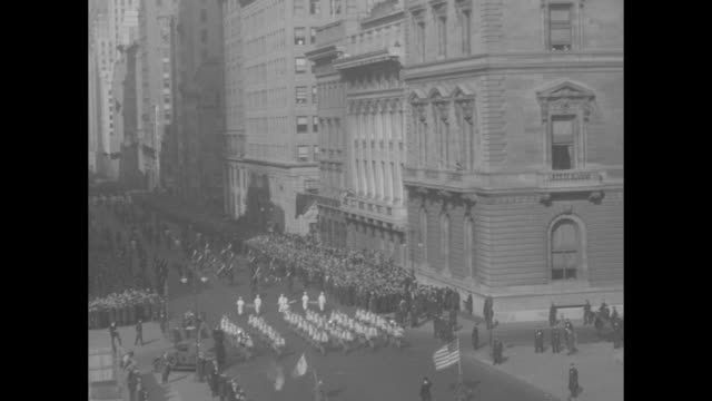 """fifth avenue stirred by irish parade"" / aerials of st. patrick's day parade / bishop john dunn and others watch parade / parade continues / child... - st. patrick's day stock videos & royalty-free footage"