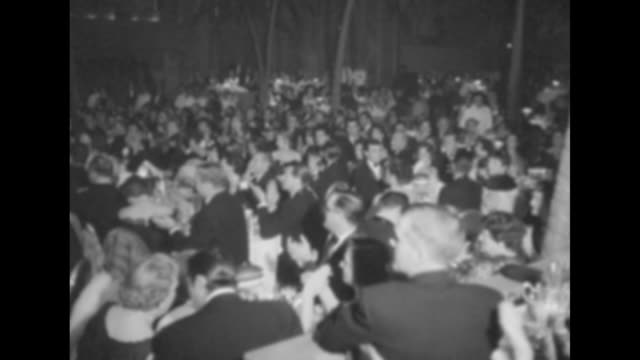 film folk get press club's 'golden globes' superimposed on scene in cocoanut grove nightclub at los angeles' ambassador hotel / new star of the year... - gregory peck stock videos and b-roll footage