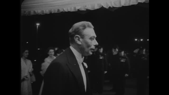 film stars at royal command performance superimposed over crowd scene in evening wear / royal family arrives for the command performance of the movie... - gregory peck stock videos and b-roll footage