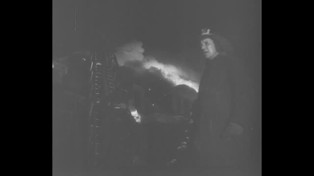 """stockvideo's en b-roll-footage met """"fire destroys red embassy at ottawa"""" superimposed over night shot of burning soviet embassy building, with truck in foreground / night: emergency... - fire hose"""