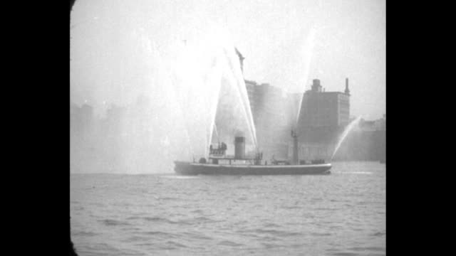 fireboat flagship shows its power new york reconstructed john purroy mitchell spouts 9700 gallons per minute in test on east river / various shots... - river east stock videos & royalty-free footage