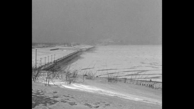 fires wrecks and delays are winter's toll / pan ice on lake michigan in chicago on the lakefront / shoveled path through deep snow / rail plow... - michigan stock videos and b-roll footage