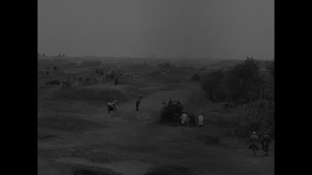 first pictures conrad takes british golf superimposed over golf course / cu british amateur scoreboard / american and british flags / sign saying no... - joseph conrad bildbanksvideor och videomaterial från bakom kulisserna