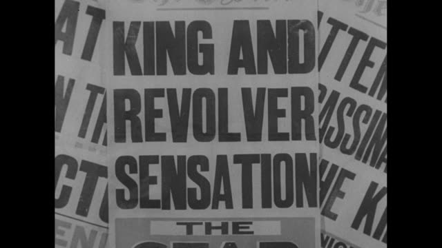 First pictures King at Review escapes death / large newspaper headlines about assassination attempt / VS people reading papers / ext Bow street...