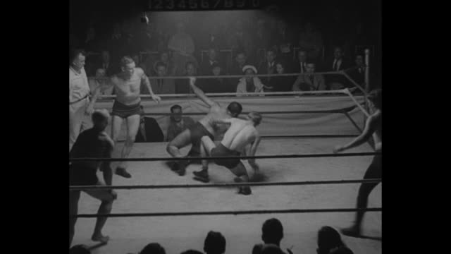 'Five Men in a Ring Ñ And ANYTHING OK' / five men in ring wrestling / crowd shouting and cheering / wrestling becomes bareknuckle fighting / referee...