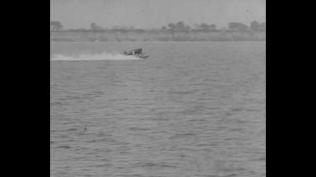 flies at 368 miles an hour isle of wight briton sets new seaplane mark in fastest air race at the coupe d'aviation maritime jacques schneider / man... - military ship stock videos and b-roll footage