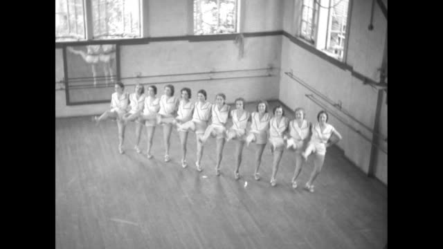 """jacksonville dancing group at gary ford academy show what dixie debs can do"""" / high angle view of jacksonville dancing group arm in arm, kicking legs... - tänzerin stock-videos und b-roll-filmmaterial"""