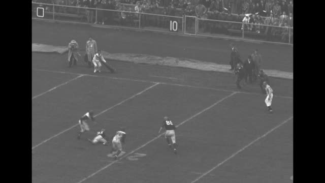 Football Highlights superimposed over school pennants Penn vs Princeton superimposed over football game / Jack Moses catches pass runs for Penn...