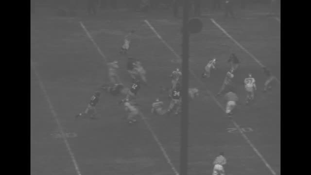 football highlights / title georgia vs villanova superimposed over game on field / villanova's joe mcnicholas long pass to ralph cecere who runs for... - joe pass stock videos and b-roll footage