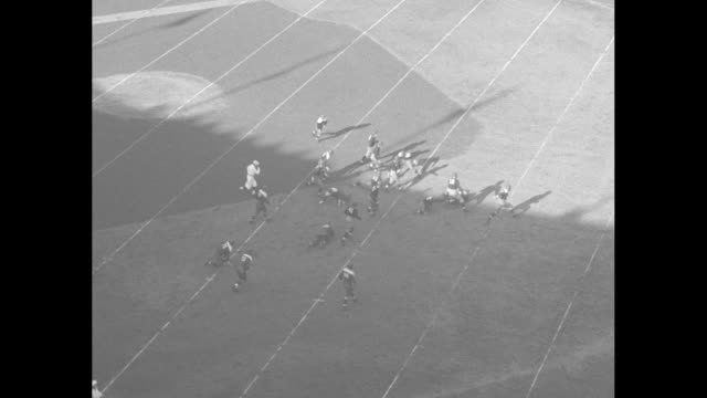 football thrills / high angle fordham rams kickoff to saint mary's gaels / vs game / st mary's allen nichelini running dodging tackles being forced... - 1934 stock videos & royalty-free footage