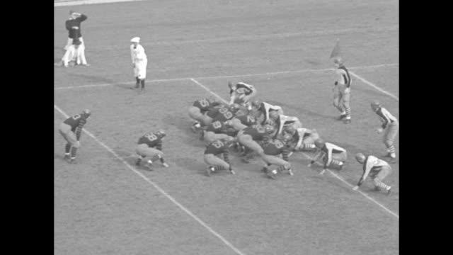 football thrills michigan princeton tulane and army reach midseason peak / mls princetoncolumbia game at princeton's palmer stadium princeton's gary... - american football ball stock videos & royalty-free footage