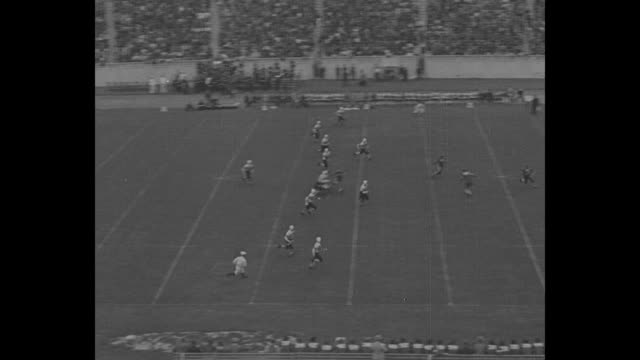 """""""football's here! major eleven clash"""", """"duke- 6 colgate- 0"""" score superimposed over filled stadium / vs football game and crowds in stands / - colgate university stock videos & royalty-free footage"""