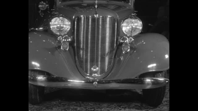 for american on wheels new york the latest in 1933 rolling stock streamlined cars feature modernistic trend at opening of the 33rd national auto show... - limousine luxuswagen stock-videos und b-roll-filmmaterial