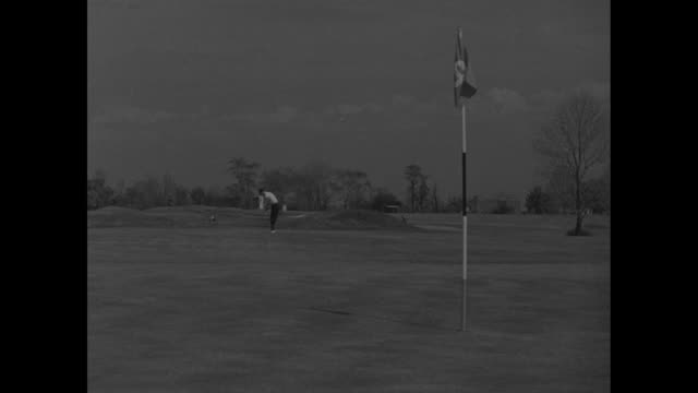 """""""fore!"""" / golfers walk across course at oakmont country club / course with small hills / golf ball on furrowed ground, shoes and pant legs next to it... - pga stock videos & royalty-free footage"""