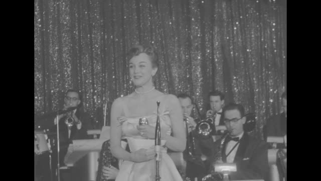 foreign press awards honor top stars superimposed over ws attendees at the golden globes ceremony at the cocoanut grove in the ambassador hotel in... - gregory peck stock videos and b-roll footage