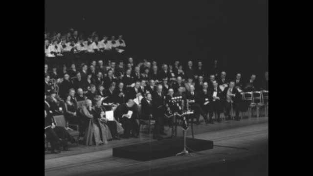 stockvideo's en b-roll-footage met former governor alfred e smith / three shots of smith standing at podium on stage of radio city music hall speaking during a religious service... - al smith