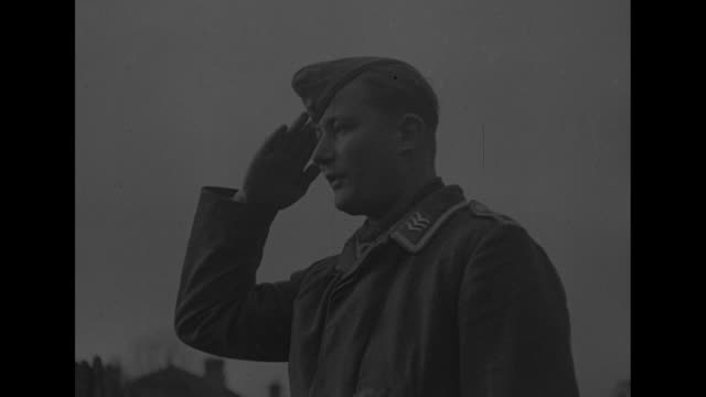 france captured germans go to prison camps / view through wire fence of german prisoners in yard exercising / two shots of prisoners exercising /... - prison camp stock videos & royalty-free footage
