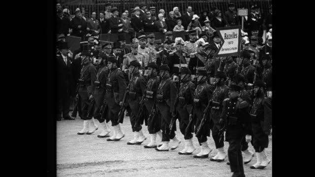 france parades military might on bastile [sic] day greatest massing of troops in paris since world war recalls glories of colonial conquest as picked... - regiment stock videos & royalty-free footage