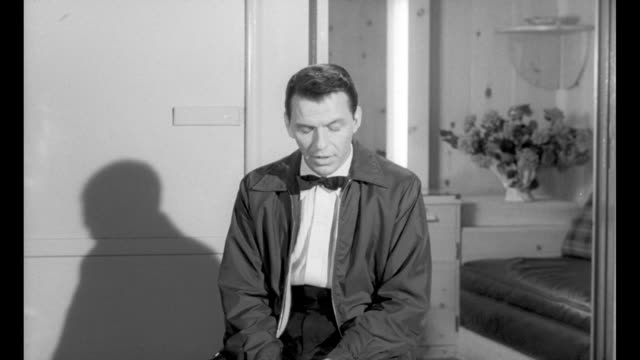 """frank sinatra speaks up for brotherhood"" / frank sinatra wears casual jacket and bow tie as he speaks; his shadow is visible behind him and he is... - frank sinatra stock videos & royalty-free footage"