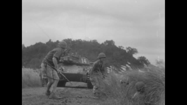french blast red ambushes in indochina superimposed on silhouette of a moving french tank / french artillery piece fires / front view of artillery... - esercito militare francese video stock e b–roll