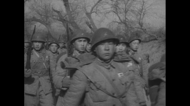 fresh troops join north china battle / vs nationalist chinese soldiers on horseback marching with upraised rifles / bactrian camels carrying supplies... - insignia stock videos and b-roll footage