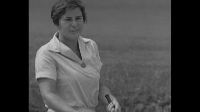 gene sarazen gives a valuable golf tip / helen hicks and gene sarazen stand in sand trap / hicks asks for a help on a shot she had trouble with /... - golf swing women stock videos & royalty-free footage
