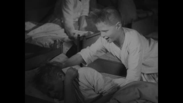german orphans find happy home berlin daily work is play to healthy crop of waifs being raised in municipal asylum / two shots of boys in bed being... - card table stock videos and b-roll footage
