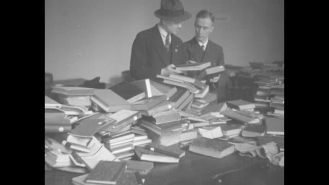 stockvideo's en b-roll-footage met germans burn books berlin paramount news records hitler destruction of ungerman books university students collect blacklisted works for huge bonfire... - 1933