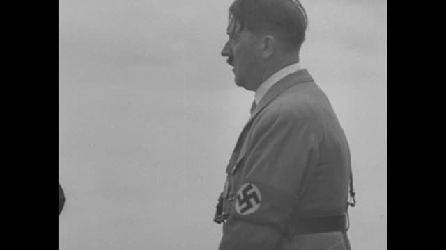 germany superimposed on slowly swirling smoke / cu adolf hitler speaking / wv huge crowd assembled in stadium listening to hitler speaking / german... - nazi germany stock videos and b-roll footage