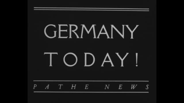 """germany today!"" / paul von hindenburg walks down steps from garrison church / brown shirts with linked arms stand in line with backs to crowd... - adolf hitler stock-videos und b-roll-filmmaterial"