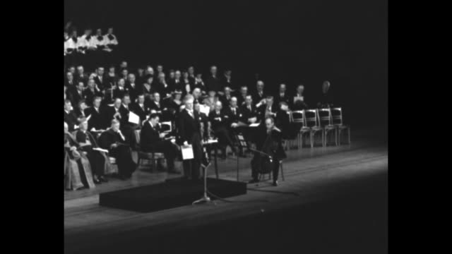 """""""giovanni martinelli, famous opera star"""" / interior radio city stage / holy year jubilee in commemoration of death of christ / dignitaries, including... - ユダヤ教点の映像素材/bロール"""
