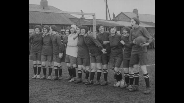 stockvideo's en b-roll-footage met girls fight for football crowndarlington enghusky women scrap like yorkshiremen in their annual rugby contest / girls' rugby team players holding... - rugby sport