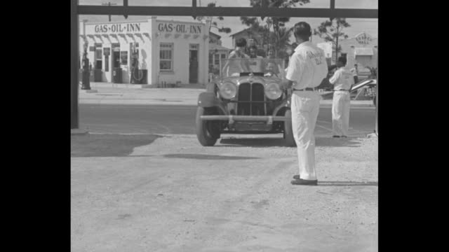 """""""give the little bus a dippy ride, miami, fla. - latest fad of motoring tourists is roller coaster for gasoline chariots"""" / car with young people,... - no smoking sign stock videos & royalty-free footage"""
