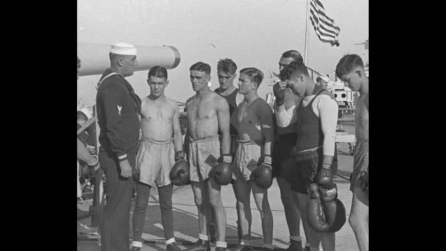 gobs of hard knocks san pedro cal the call to gloves sailors aboard uss colorado train to 'meet the enemy' in floating ring / bugler sailor on deck... - boxer shorts stock videos and b-roll footage