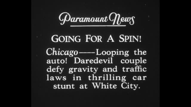 vídeos de stock, filmes e b-roll de going for a spin chicago looping the auto daredevil couple defy gravity and traffic laws in thrilling car stunt at white city / woman and two men... - mês