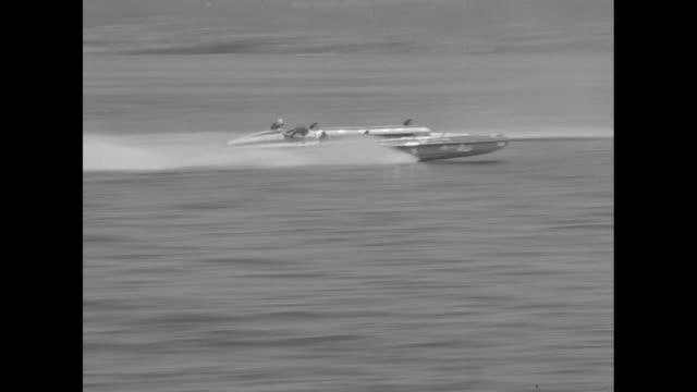 vídeos y material grabado en eventos de stock de gold cup race slomoshun iv finishes alone superimposed over hydroplane slomoshun iv speeding along water during the apba gold cup race at lake... - hidroplano