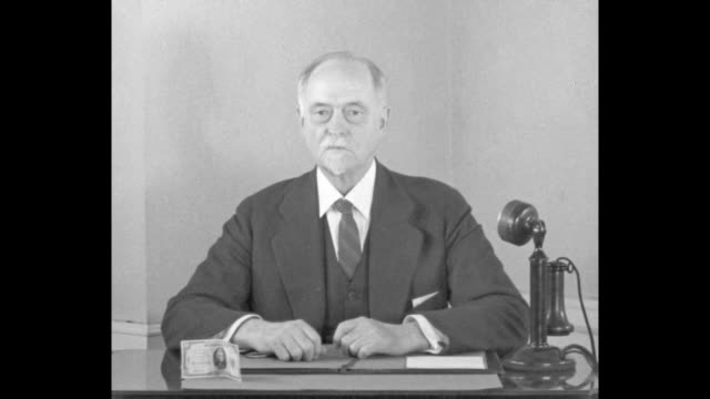 """""""gold flows to u.s.! new york - new 'stabilized dollar' brings rush of european gold shipments! prof. irving fisher explains 1934 money law"""" / sot... - us coin stock videos & royalty-free footage"""
