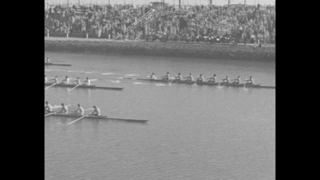 """""""golden bears win crew sprint title"""" / race of four crews begins / race past low bridge / aerials race / spectators watch from stands, flags from... - university of california stock videos & royalty-free footage"""