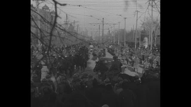government victory follows army triumph in harbin manchurian rail center fresh regiments relieve troops who took city / mounted japanese troops... - 1930~1939年点の映像素材/bロール
