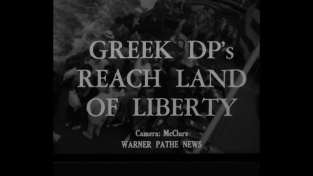 """greek dps reach land of liberty"" superimposed over group of displaced persons / dps on ferry boat wave at statue of liberty / man smiling widely /... - statue of liberty new york city stock videos & royalty-free footage"