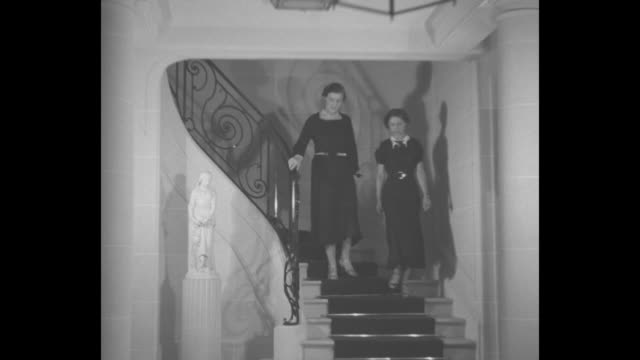Greek Princess Marina bridetobe of England's Prince George tells her wedding plans / MS Princess Marina descending staircase talking with friend / CU...