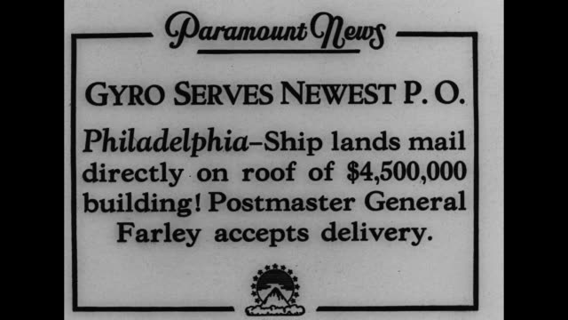 """""""gyro serves newest p.o. - philadelphia - ship lands mail directly on roof of $4 000 building! postmaster general farley accepts delivery"""" / aerial... - 航空便点の映像素材/bロール"""