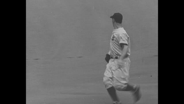 Hail Gehrig Batting 'Em Since 1925 / title Yankee Stadium New York superimposed over crowd in stands / CU Gehrig on field / George M Cohan gives...