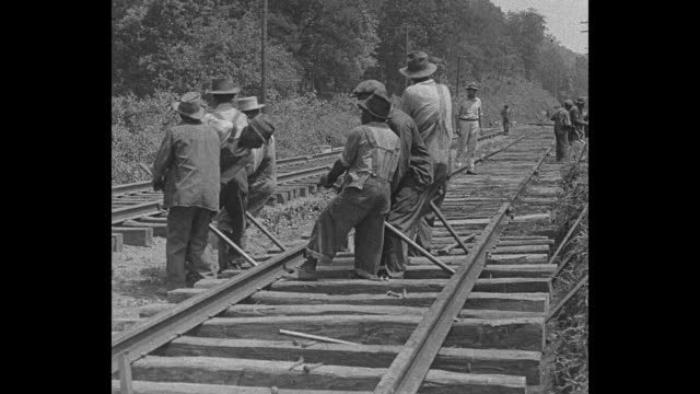 """hammers make railroad music - vaughan's gap, tenn. - dusky track workers find way to make it seem play"" / a group of african-american railroad... - rail transportation stock videos & royalty-free footage"