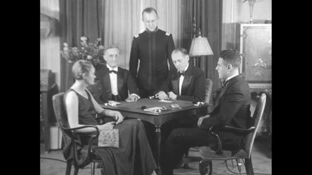 """vidéos et rushes de sidney lenz and ely [sic] culbertson seek to prove their systems of bidding best in card battle of the century"""" / bridge players at card table, left... - cartes à jouer"""
