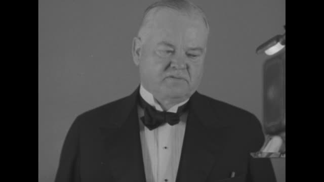 "herbert hoover"" superimposed over fade in to mws of president herbert hoover standing at table with others sitting on either side of him / sot... - fade in video transition stock videos & royalty-free footage"