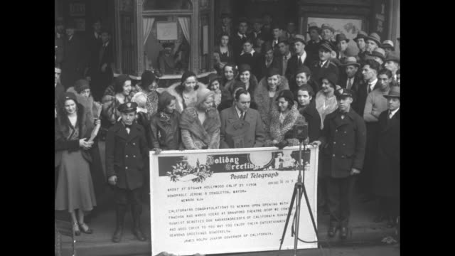 vídeos de stock e filmes b-roll de harry goldberg presents key to city at branford theater / mws large group gathered on sidewalk outside branford theater behind harry goldberg and... - 1931