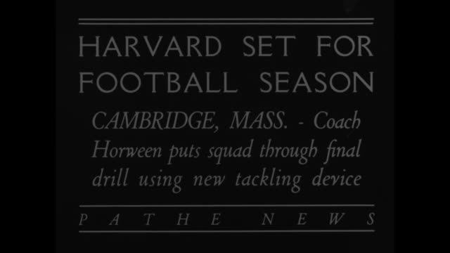 """""""harvard set for football season-cambridge, mass-coach horween puts squad through final drill using new tackling device"""" / players practice on field... - practice drill stock videos & royalty-free footage"""